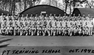 Motor Torpedo Boat Squadron Training Center, class of December 1942 (photo Oct. 1942), Mellville, RI.  Lt. (jg) John F. Kennedy is in the back row, seventh from right.