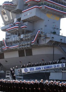 Sailors take their final walk down the brow of USS John F. Kennedy (CV 67) during the decommissioning ceremony. U.S. Navy photo by Mass Communication Specialist 2nd Class Susan Cornell.