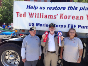"(L-R) David Gamache, Bill Sheridan and Pat Gamache pose with our 1st and 2nd prize ribbons from the 2013 North Providence Memorial Day Parade ""Best Float"" awards"