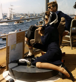 The President and Mrs. Kennedy view the first of the 1962 America's Cup races aboard the destroyer USS Joseph P. Kennedy Jr., off Newport, Rhode Island, 15 September 1962. Photograph by Robert Knudsen, White House, in the John F. Kennedy Presidential Library and Museum, Boston.